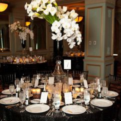 Chair Covers And More Houston Wholesale Folding For Sale Black Tablecloth, Chairs, Vase With White Green Floral Arrangement As ...
