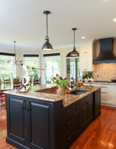 This large center island features black cabinetry and neutral granite countertops not only does it also rh pinterest
