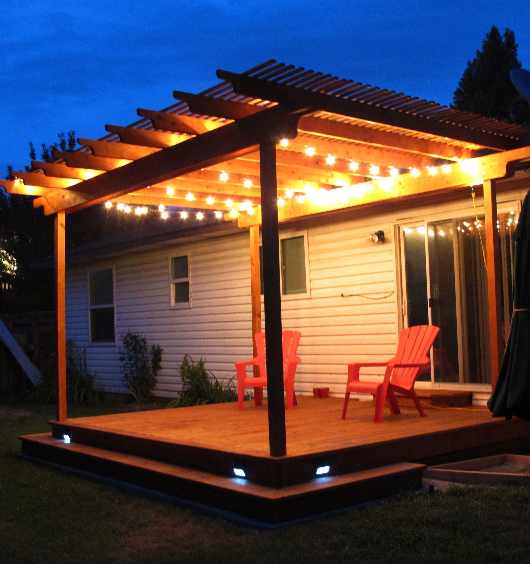 Awesome pergola deck with wraparound step and strand