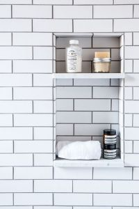 Built in shower nook, with white subway tiles and dark ...