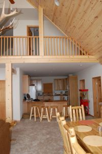 Interior photo of chalet style modular home with tru vault ...