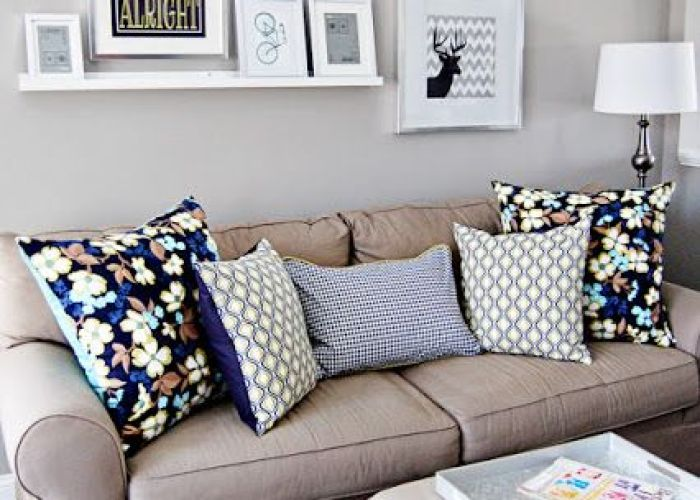 Love the idea of neutral walls and furniture but adding pillows with  bold color above tv decorliving room wall decor ideas also