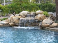 luxury pools   stone walk in pool w beach sand luxury ...