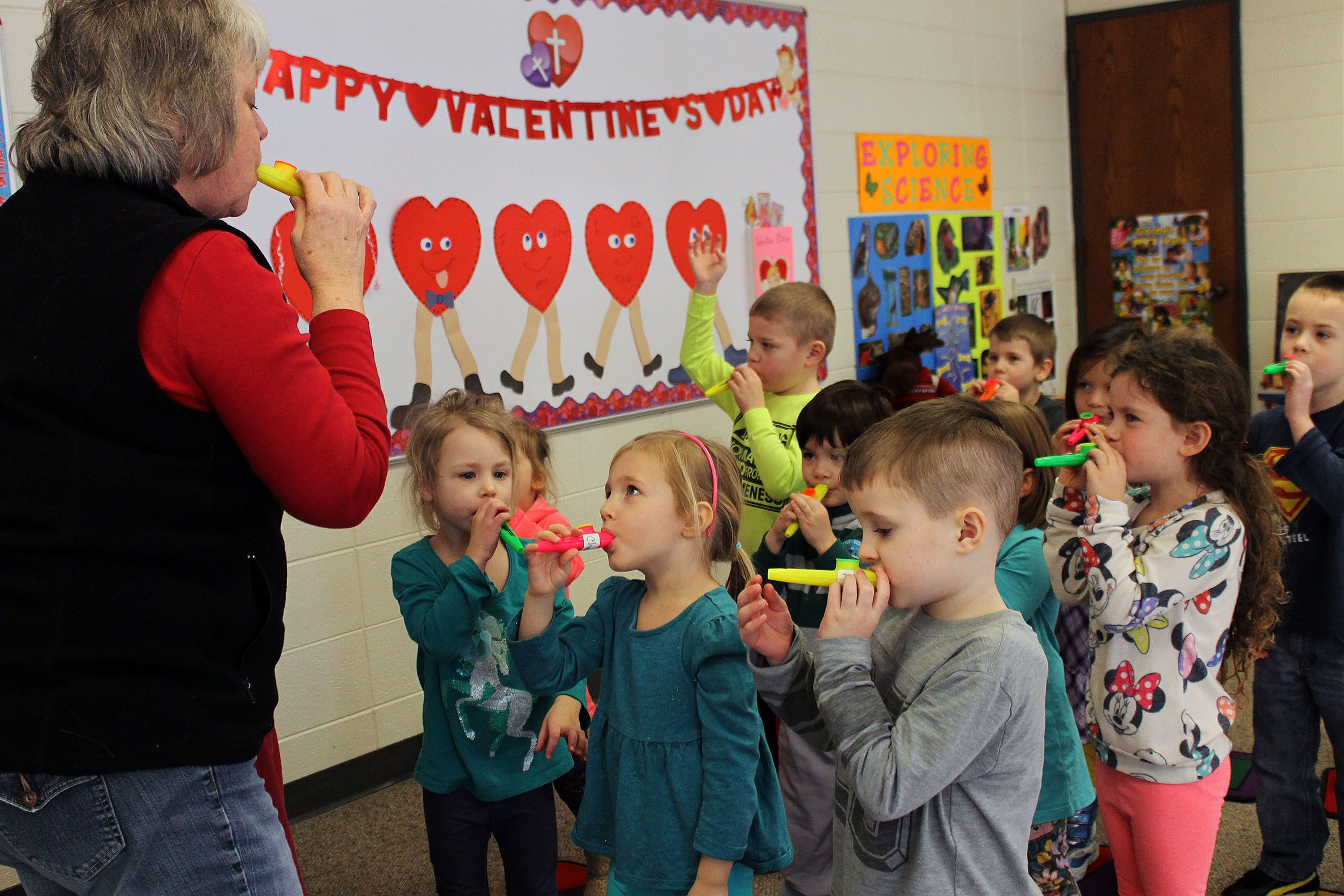 Director Pat Johnson left leads her class at Bethesda Christian Preschool in a song The