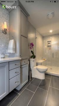 Bathroom - Dark grey tile flooring, light grey cabinets ...