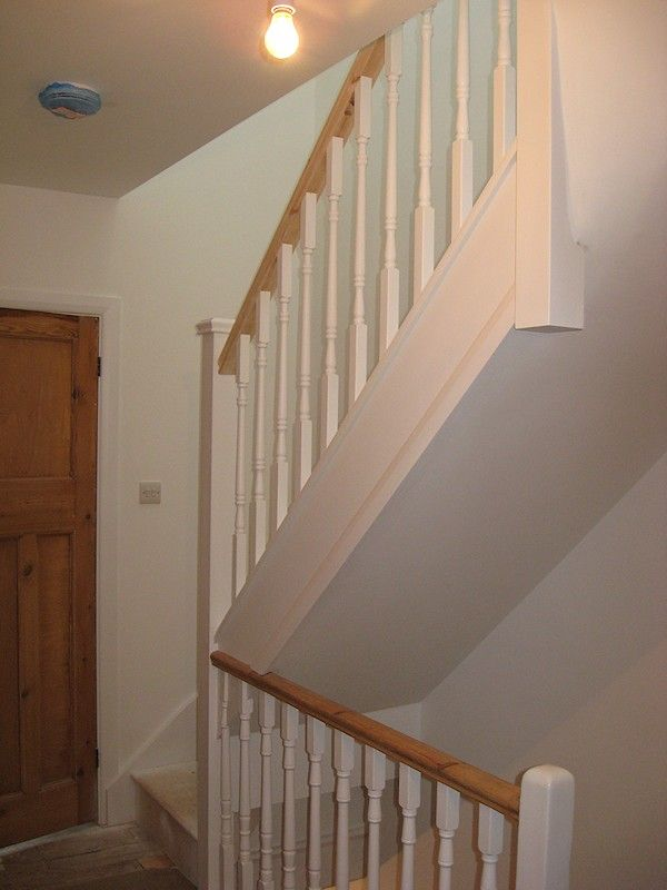 A softwood staircase for a loft conversion, painted white