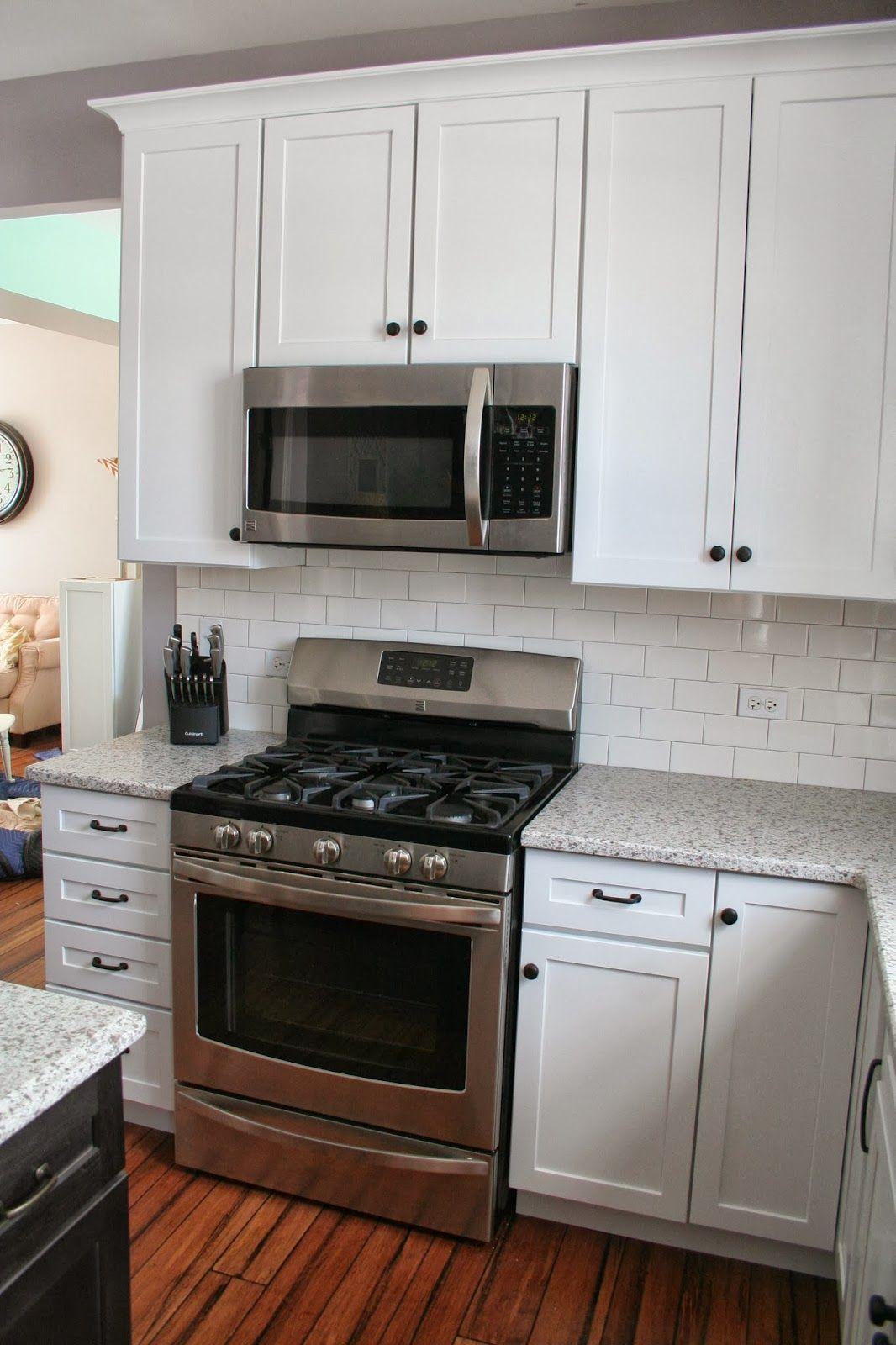 White shaker cabinets with Restoration Hardware Dakota