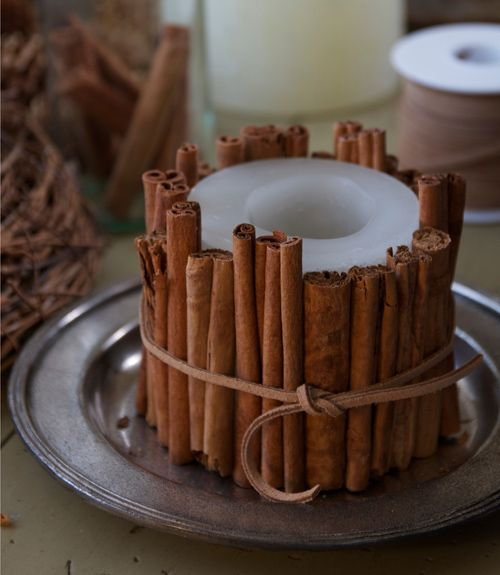 dress up plain candles to get a custom look with little effort this cinnamon stick