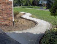 Winding broom finish standard concrete walkway with ...