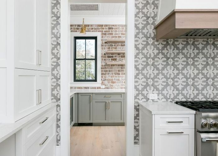 Sherwin williams pure white kitchen with oak hardwood floor and grey cement tile also