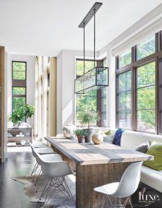 To allow for dining as many people designer andrea goldman conceived  upholstered banquette which she paired with reclaimed oak plank table also modern kitchen iconic seating kitchens rh pinterest