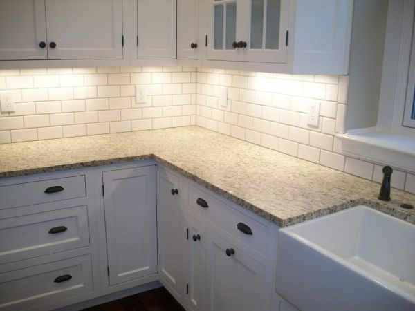 white kitchen cabinets with subway tile backsplash White Tile Kitchen Backsplashes | shade of white subway