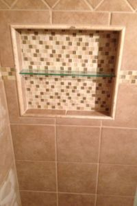 Recessed/ built in tiled shower shelf.