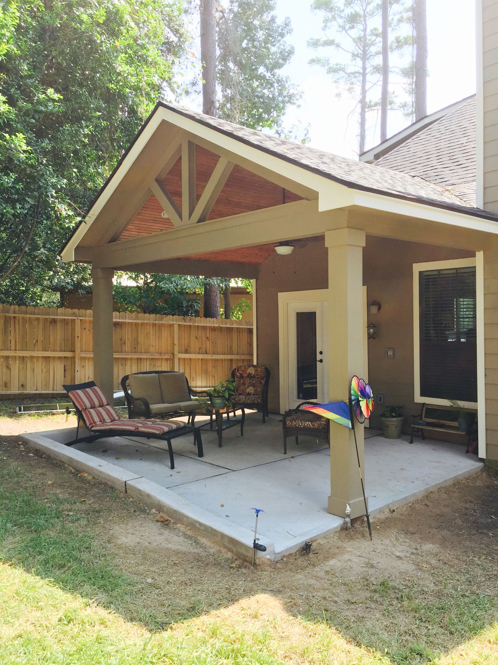 Gable roof patio cover with wood stained ceiling