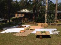 Backyard engagement party picnic area. Pallet tables. Mix ...