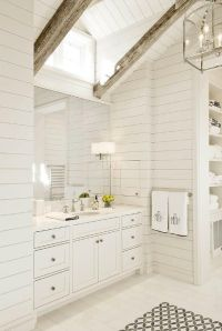 White master bathroom features a shiplap vaulted ceiling