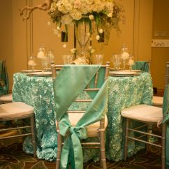 Teal Chair Covers For Wedding Inexpensive Pool Lounge Chairs Rosette Tablescape With Bows And White