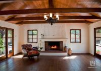 Spanish Mediterranean family room with plaster fireplace ...