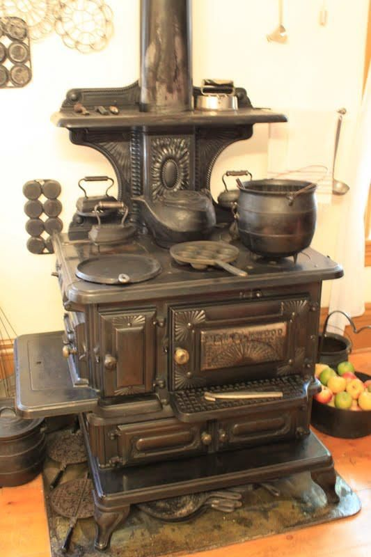 An Old Wood Burning Cook Stove With All Of The