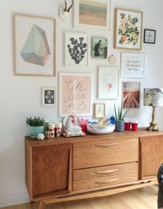 Love this gallery wall with cool colors and mid century furniture also rh pinterest
