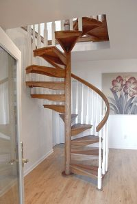 Spiral staircase / wooden steps / open / indoor