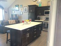 Small spaces: Open Concept: Kitchen and living room. Dark ...