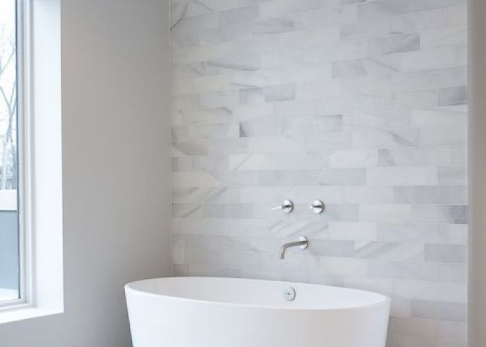 White marble tile with wall faucet and standalone tub leo designs chicago also bathrooms clad accent