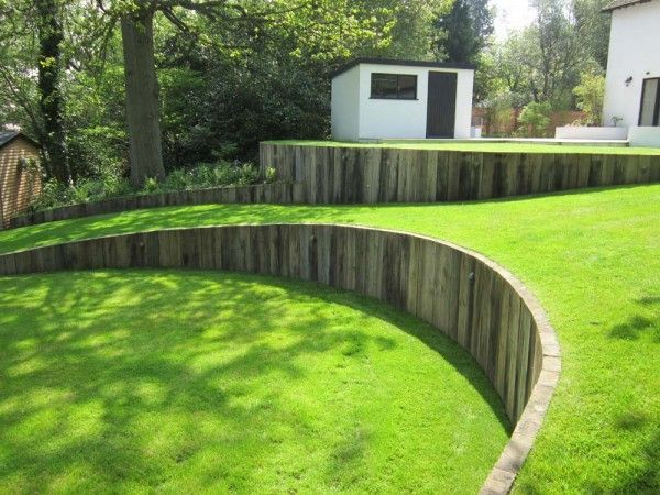 Curved Timber Retaining Wall With Vertical Railway Sleepers Great