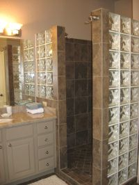 Custom walk in shower with no door and glass block for