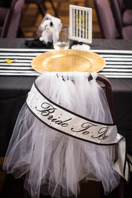 Adorn brides chair at bridal shower with tulle resembling