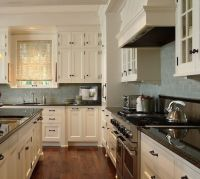Perfect kitchen color scheme. Dark granite and cream ...