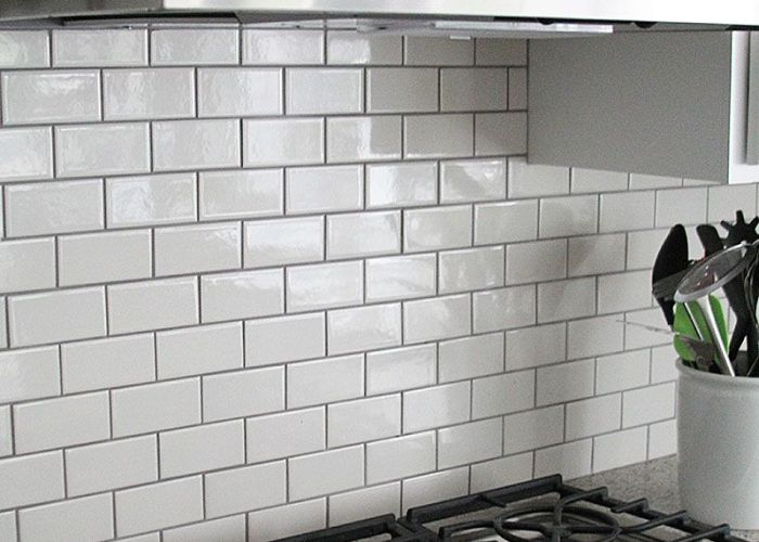 Gray grout with white subway tiles helps keep the kitchen from being  also best images about floors backsplash on pinterest