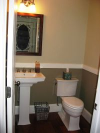 pedestal sink, dark floors, chair rail