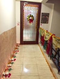 Entrance decorations for Diwali. Wreath, rangoli, candles ...