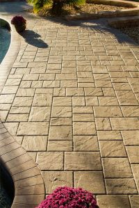 The beautiful texture of Tremron Stonehurst pavers adds a ...