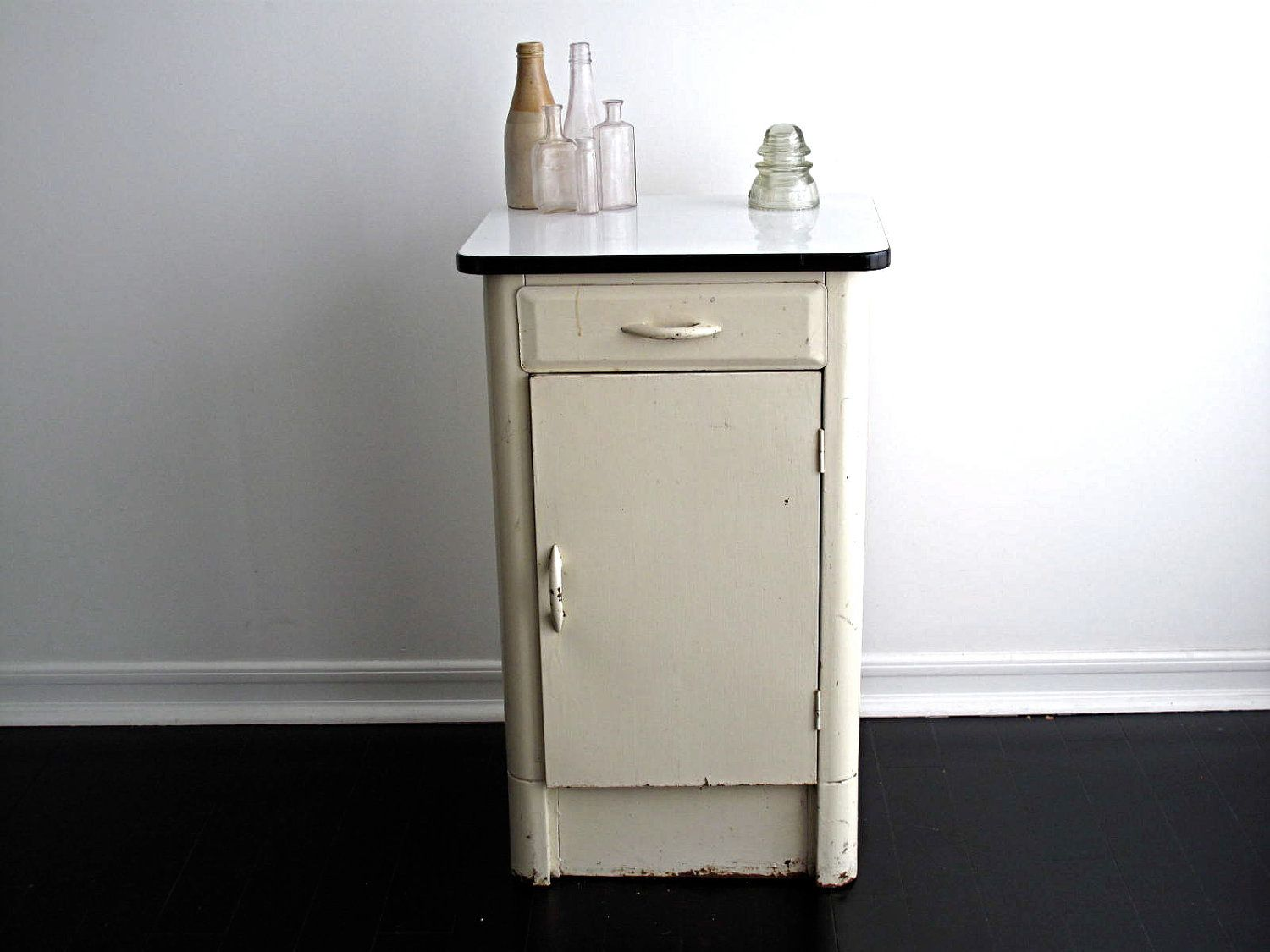 Vintage White Metal Cabinet with an Enamel Top via Etsy