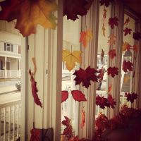 Fall bay window decorating idea... fabric leaves tied onto ...