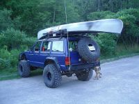 this one has it all: cherokee, tire carrier, roof rack ...
