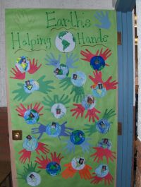Earth's Helping Hands classroom door decoration for Earth ...