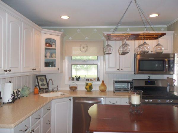 White Kitchen With Island & Hanging Wine Glass Rack