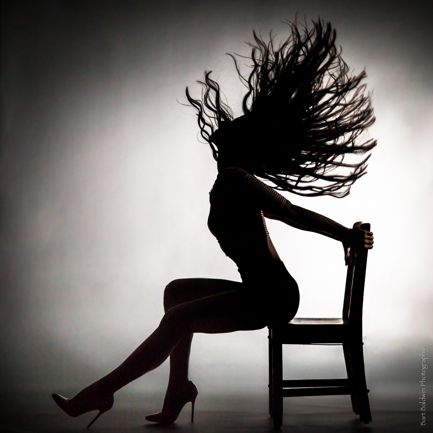 on chair dance leather dining room chairs with casters shannon watson silhouette or girl slinging hair while