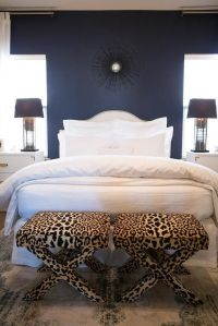 White and navy blue bedroom features an accent wall ...