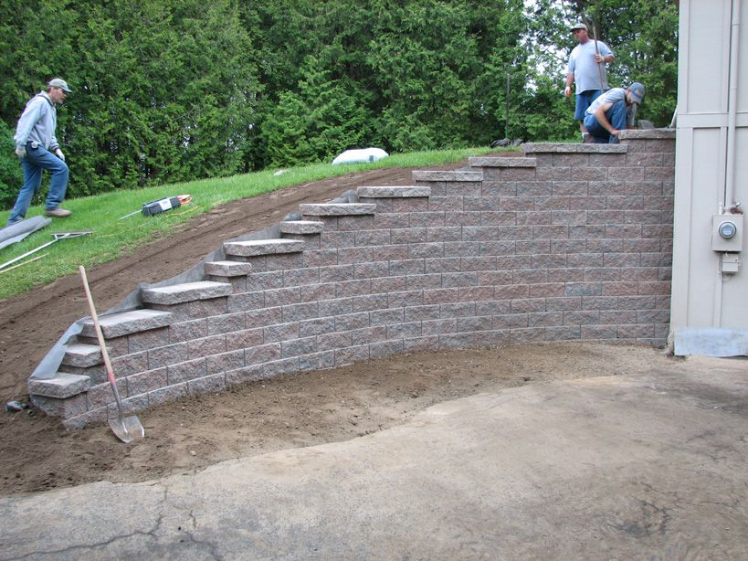 hillside front yard with retaining wall