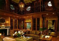 A wood paneled office / den of approximately 17 x 14 feet ...
