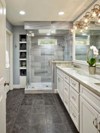 This beautiful master bathroom pulls elements from ...