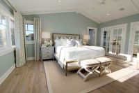 Steely light blue bedroom walls, wide-plank rustic wood ...