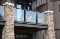 Glass railing balcony with stone pillars | Century ...