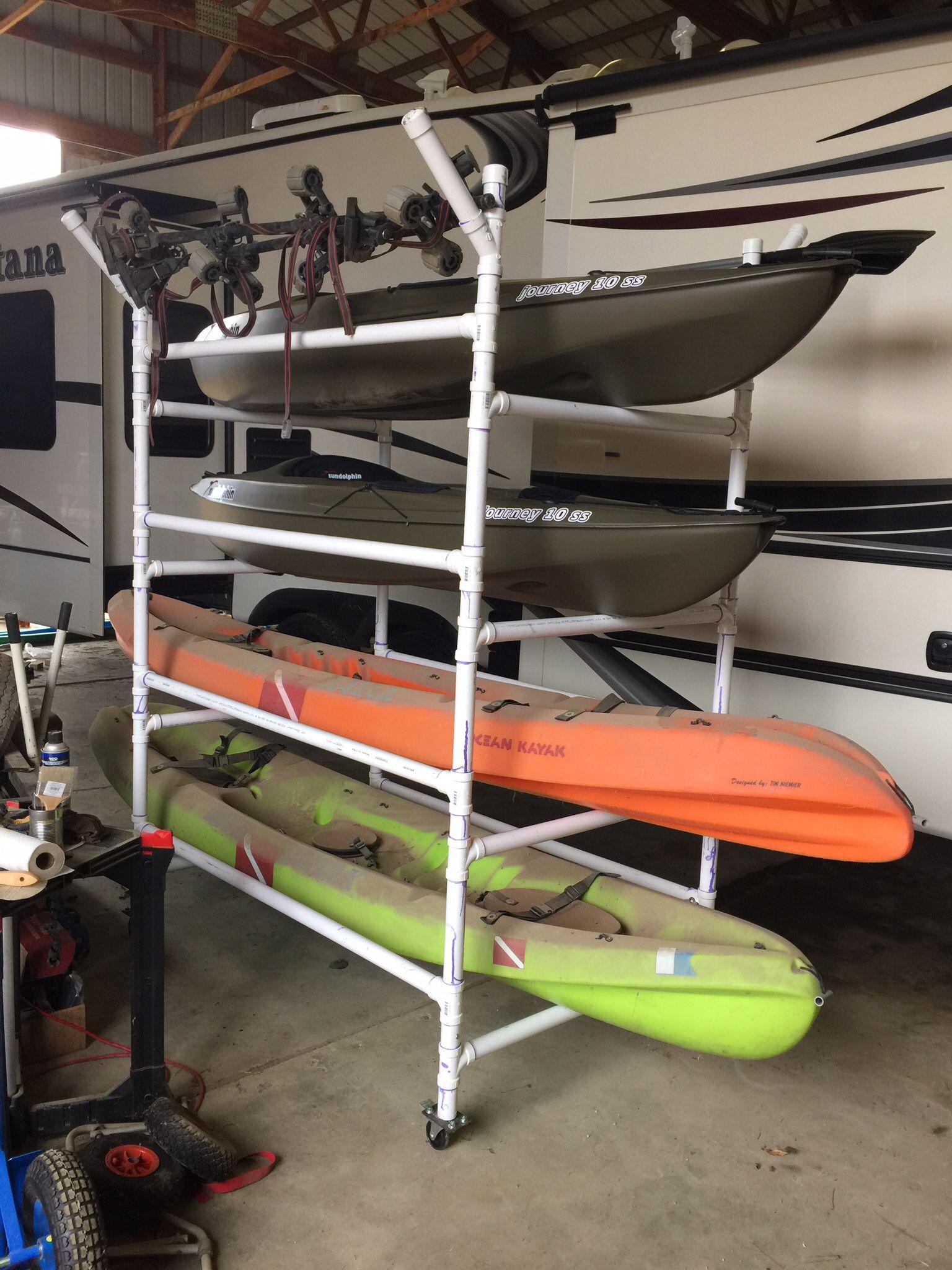 Homemade PVC kayak rack , can store 4 kayaks,paddles