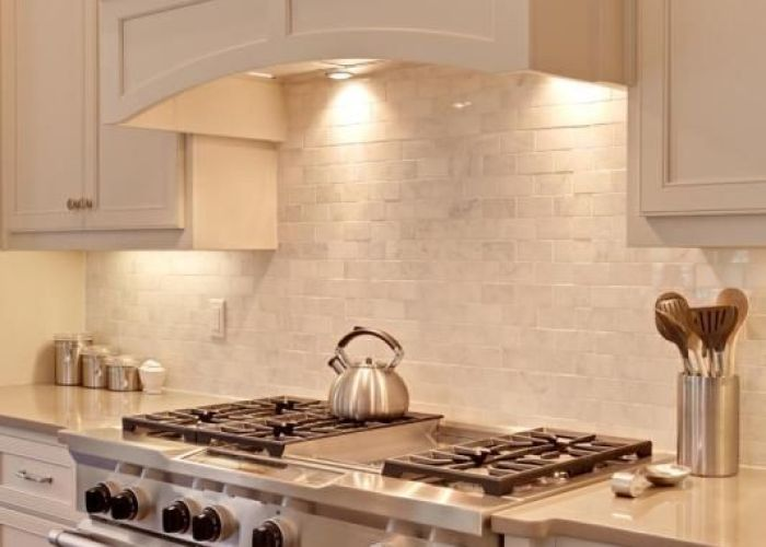 Enell kitchen hood with mexican blue tiles as  backsplash also range front modified and extended out dream palace