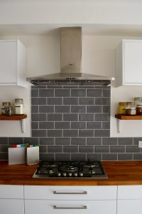 Grey metro tiles with AEG gas hob and extractor fan #grey ...